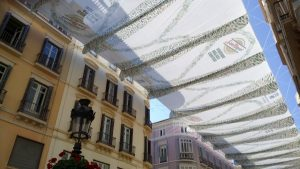 avoid the hot weather in Malaga in Calle Larios