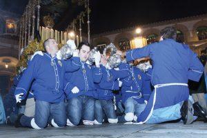 Kneeling throne bearers in Holy Week in Malaga