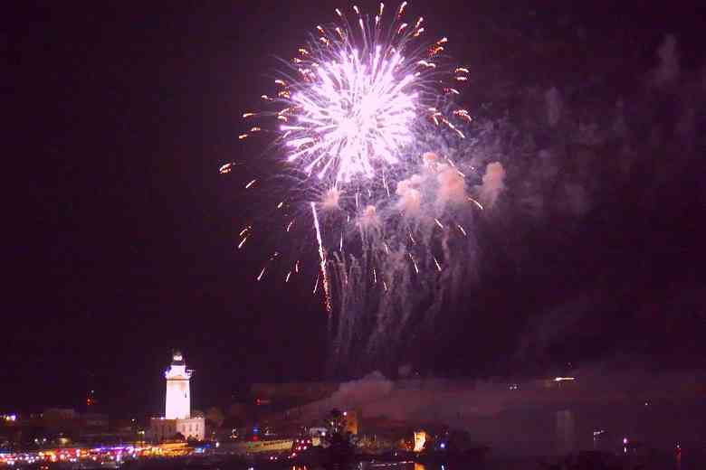 Malaga Fair firework display over lighthouse