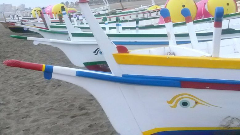 jabega boats in Malaga lined up on the beach